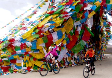 Cycling past prayer flags